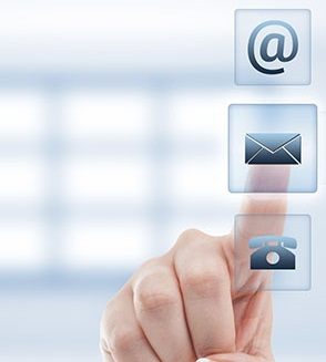 contact us picture, illustration. We can see a hand touching an envelop on a digital screen